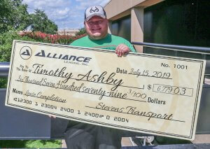image of Timothy Ashby with lease completion bonus check
