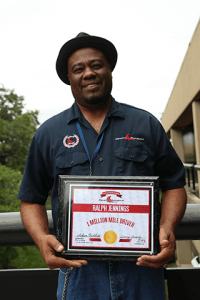 Image of truck driver Ralph Jennings with award plaque