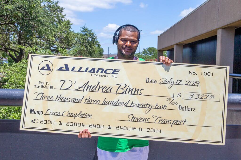 image of truck driver with bonus check