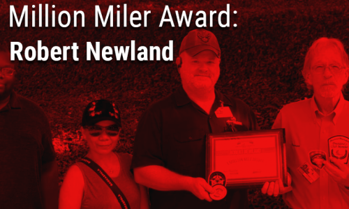 image of driver Robert Newland with Million Mile award plaque