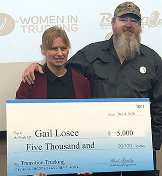 image of Gail Losee with Transition Trucking check