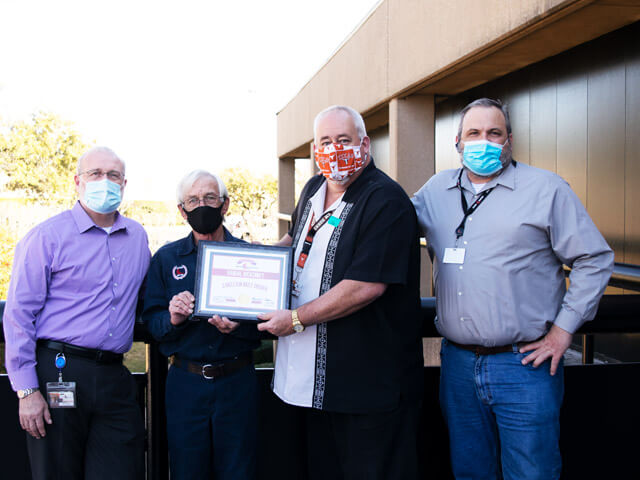 image of Stevens Transport driver receiving award plaque